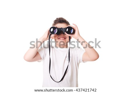 little boy is looking through binoculars. Isolated over white background. - stock photo