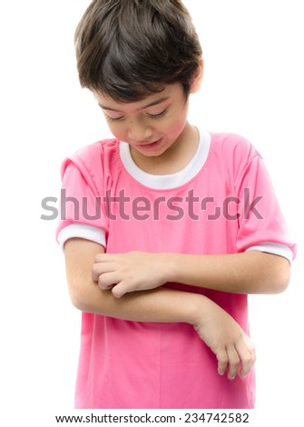 Little boy itchy his arm on white background - stock photo