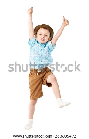 Little boy jumping and having fun isolated on white background. Positive emotions. - stock photo