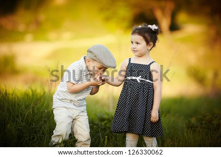 little boy kissed a girl - stock photo