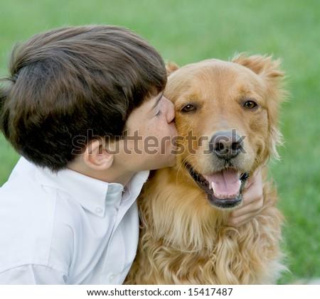 Little Boy Kissing Dog - stock photo