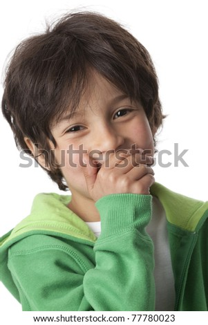 Little boy laughing behind his hand on white background - stock photo