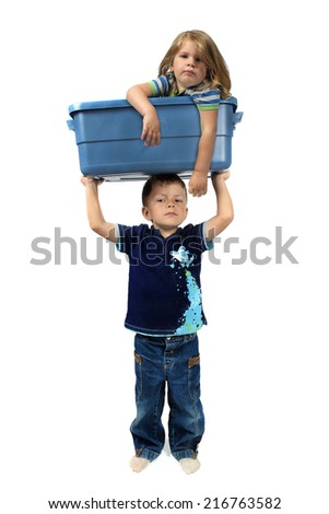 little boy lifting a girl inside a blue bin on a white background - stock photo