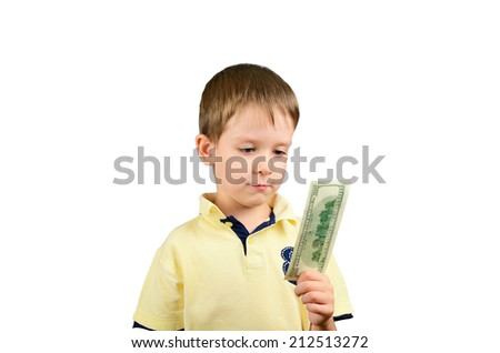 little boy looking at the bill 100 US dollars and think what to do. isolated on white background. horizontal