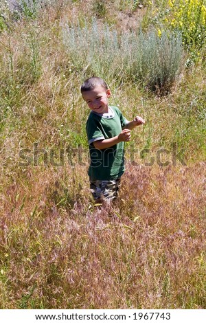Little Boy Looking back in the Prairie