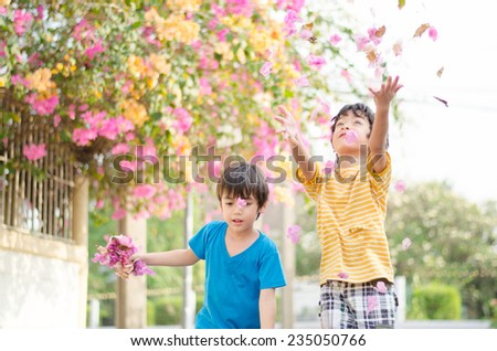 Little boy looking trough  magnifier - stock photo