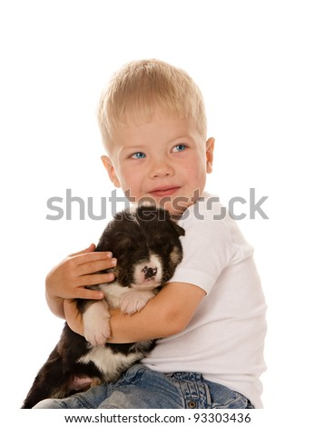 little Boy loving and bonding his puppy fluffy dog. isolated on white background - stock photo