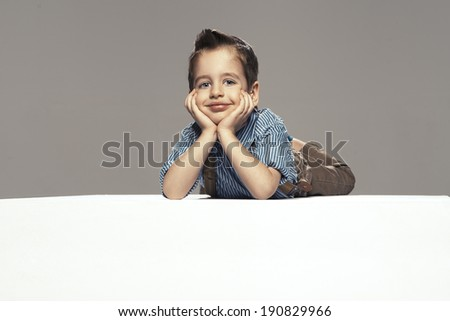 Little boy lying on the floor