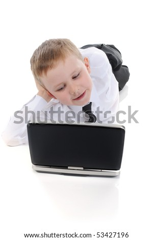 Little boy lying on the floor with a laptop. Isolated on white background - stock photo