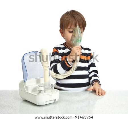 little boy makes inhalation with nebuliser - stock photo
