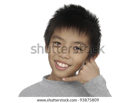 little boy making a call me gesture - stock photo