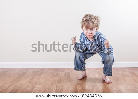 Little boy making a funny face - stock photo