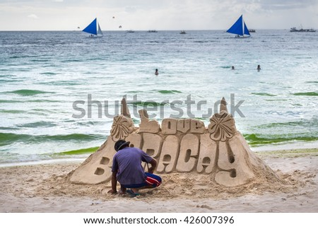 little boy making sand tower castle at white beach of  Boracay island  Philippines - stock photo