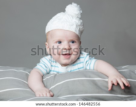 little boy on a gray background