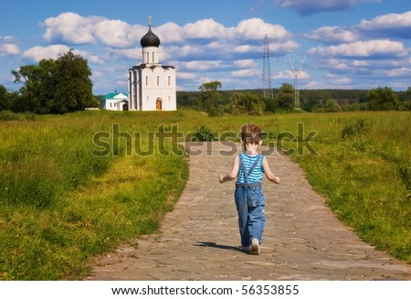 Little boy on a  orthodox church background. Church of the Intercession on the Nerl (Vladimir region of Russia) - stock photo