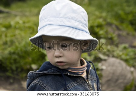 Little boy on a summer wood background - stock photo