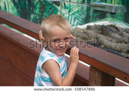 Little boy on crocodile farm - stock photo