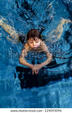 little boy on swimming lesson - stock photo