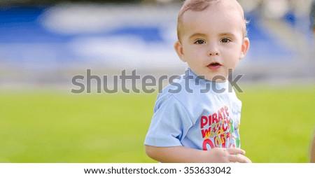Little boy on the football field - stock photo