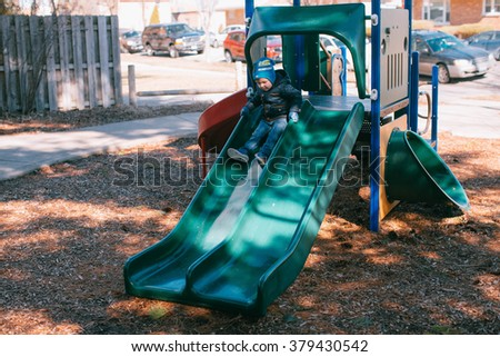 little boy on the playground - stock photo
