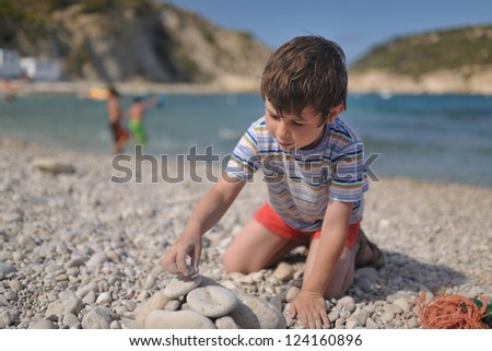 little boy on the shore