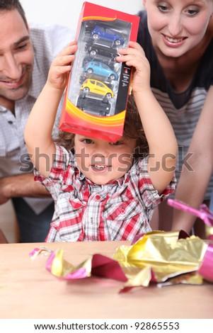 Little boy opening birthday present - stock photo