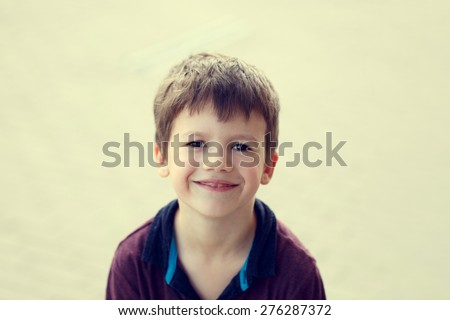 Little boy outdoor portrait in vintage style - stock photo