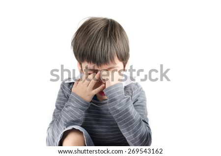Little boy pain and itchy his eyes put finger in on white background  - stock photo
