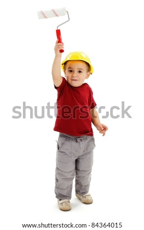 Little boy painting high with small paint roller - stock photo