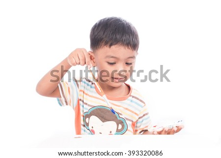 little boy painting watercolor - stock photo