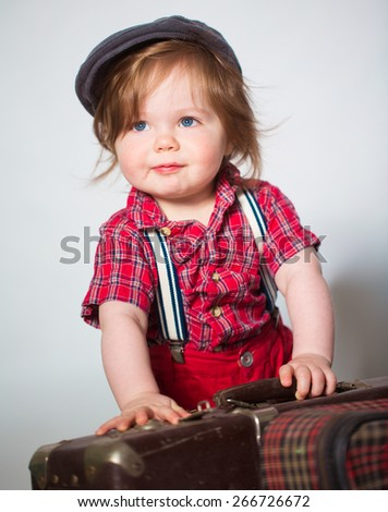 Little boy photo with suitcase - stock photo