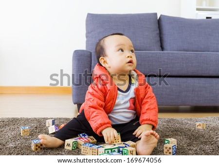 Little boy play toy block - stock photo