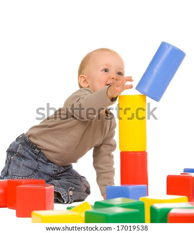 little boy play with bricks. isolated on a white background - stock photo