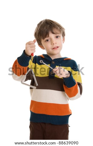 Little boy playing a triangle instrument isolated on a white background