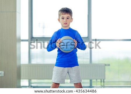 Little boy playing basketball blue ball and form - stock photo