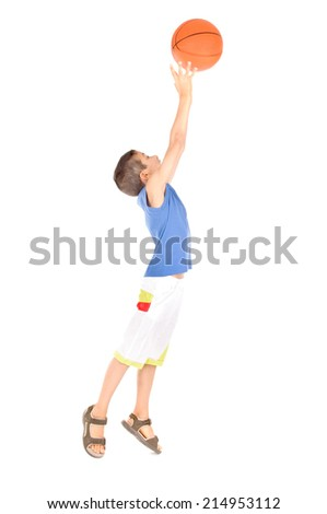 little boy playing basketball isolated in white