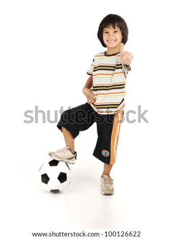 Little boy playing football isolated on white background - stock photo