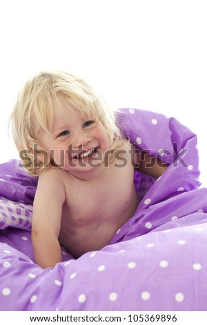 Little boy playing in bed - stock photo