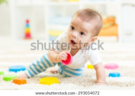 Little boy playing in children room - stock photo