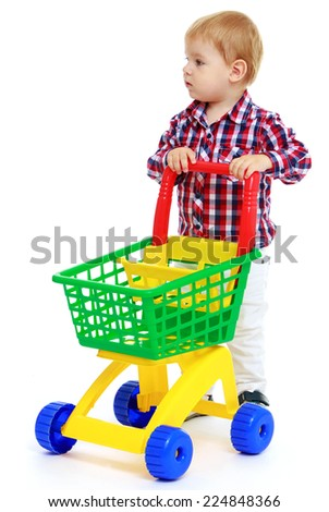 Little boy playing in the store.Early years learning a happy childhood concept.Isolated on white background. - stock photo