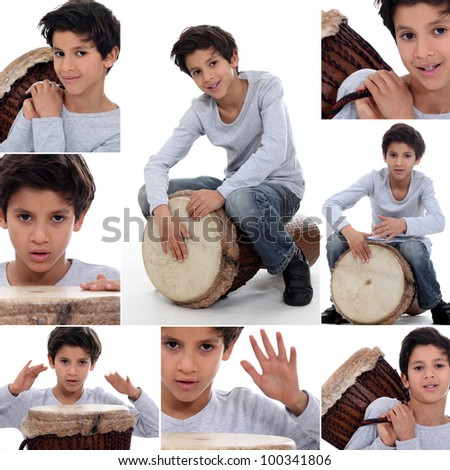little boy playing on a traditional drum - stock photo
