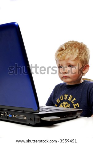 little boy playing on Laptop on white background - stock photo
