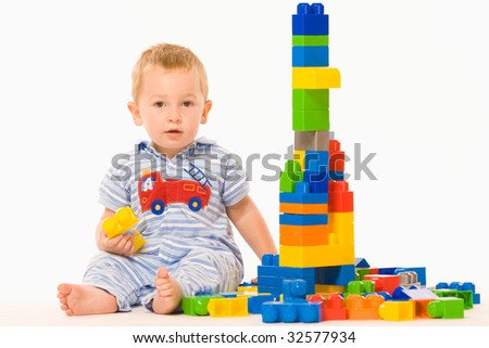 Little boy playing on white background - stock photo