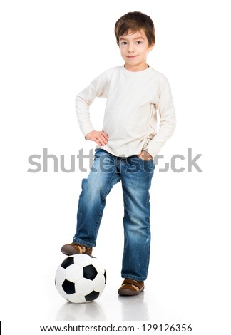 Little boy playing soccer ball isolated on white - stock photo