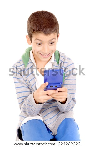 little boy playing videogames isolated in white - stock photo