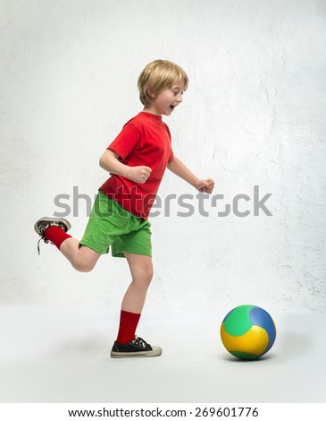 Little boy playing with a ball - stock photo
