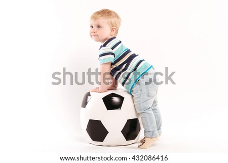 little boy playing with a ball on a white background - stock photo