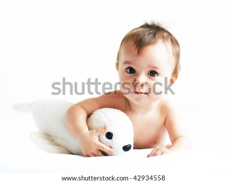 Little boy playing with a seal - stock photo