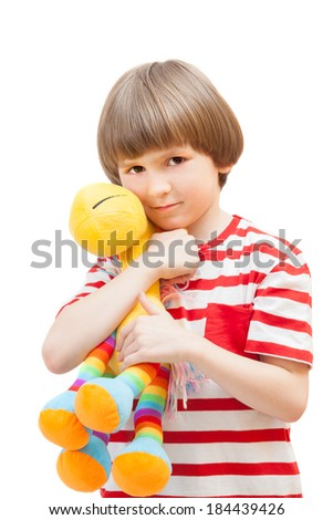 Little boy playing with a toy giraffe. Isolated on white background - stock photo