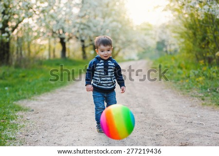 little boy playing with ball - stock photo